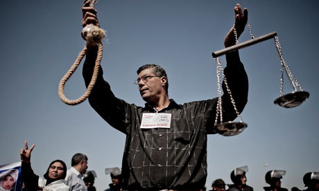 an anti-Mubarak protester demands the death penalty for ousted Egyptian president's trial in Cairo