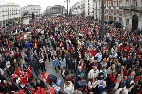 Demonstrators march during a Labor Day rally organized by Spanish two big trade-union confederations, CCOO and UGT, in Puerta del Sol square, in Madrid, central Spain, on 01 May 2013.