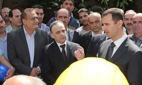 Syrian president Bashar al-Assad visits an electricity station in Damascus