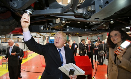 Boris Johnson turns mechanic as he and Northern Ireland Secretary Theresa Villiers tour the Wrightbus factories, makers of the London Bus, in Ballymena and Antrim.