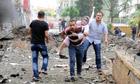 Turkey blames Syria after car bombs kill dozens near border