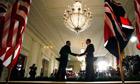 Obama Cameron shake hands