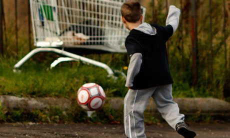 A young boy playing football