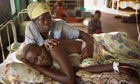 A mother cares for her daughter suffering from malaria in a hospital in Amuria, Uganda.