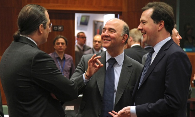 French Finance Minister Pierre Moscovici, center, talks with Swedish Finance Minister Anders Borg, left, and British Chancellor of the Exchequer George Osborne, during the EU finance ministers meeting, at the European Council building in Brussels, Tuesday, May 14, 2013
