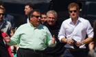 Prince Harry walks with New Jersey governor Chris Christie as they view areas of the boardwalk that have been repaired in Seaside Heights, a beach town hit by Hurricane Sandy last year.