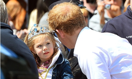 Prince Harry is greeted by a young admirer at  Mantoloking,  a borough of Ocean Heights, New Jersey during his visit to one of the areas affected by Superstorm Sandy.