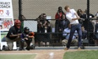 Britain's Prince Harry participates in baseball drills with Harlem RBI's youth on the Field of Dreams.