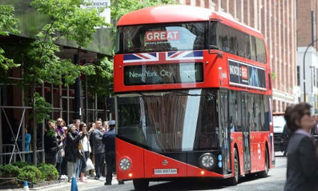 A double decker bus carrying Prince Harry and British prime minister David Cameron arrives in the Meatpacking district of New York.