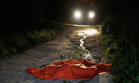 Covered-up body of a man shot dead in San Pedro Sula