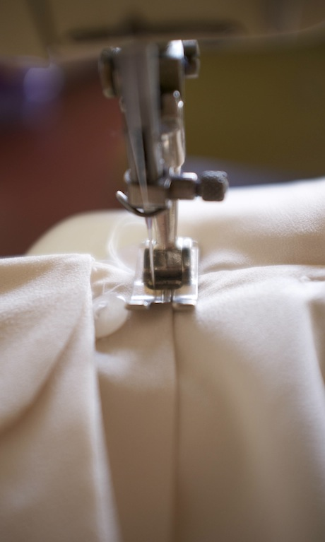 Image of a a button-down blouse on a sewing machine