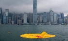 Dutch conceptual artist Florentijn Hofman's 'Rubber Duck' floats, deflated and flattened on Victoria Harbour, Hong Kong, China