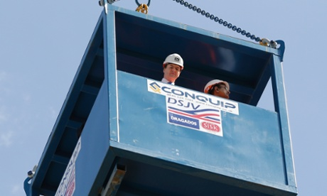 George Osborne, left, accompanied by India's Finance Minister Palaniappan Chidambaram inspect the site as they are lowered into a shaft on the Pudding Mill Lane Crossrail construction site, in east London today.