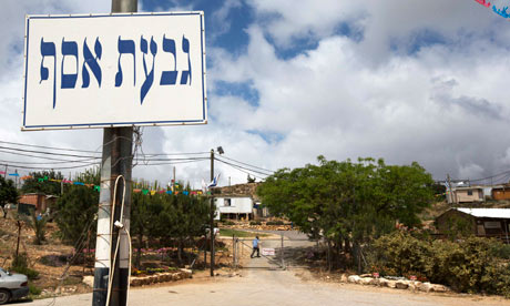 A signpost marks the entrance to the West Bank settler outpost of Givat Asaf, near Ramallah