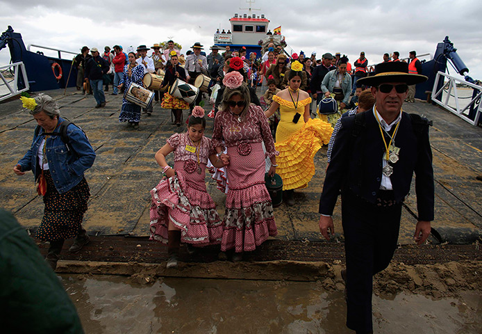 Pilgrims: Pilgrims depart from a boat as they make their way to the shrine of El Roci