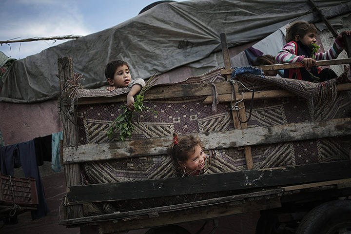 24 hours in pictures: Beit Lahiya, Gaza Strip: Palestinian refugee children play in a poverty-str