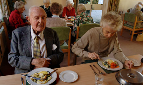 Man and lady eating in a retirement home