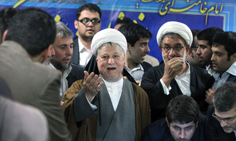 Former Iranian president Akbar Hashemi Rafsanjani, centre, registers his candidacy for the election