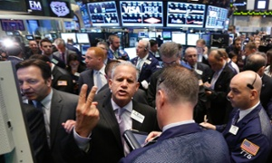 Same to you, buddy! Traders work on the floor at the New York Stock Exchange, this afternoon.