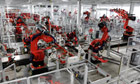 Robots assembling Tesla sports cars in California