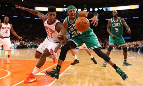Iman Shumpert of the New York Knicks and Paul Pierce of the Boston Celtics