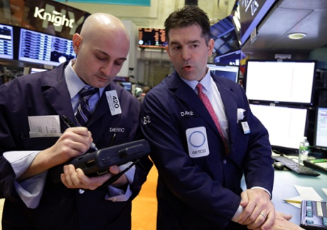 Trader Damian Bagarozza, left, and specialist David Haubner work on the floor of the New York Stock Exchange Thursday, May 2, 2013. Stocks are opening higher on Wall Street, a day after the market's biggest fall in two weeks, after General Motors and other big companies announced higher profits.