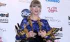 Taylor Swift with her clutch of Billboard awards