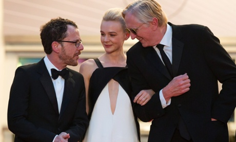 Ethan Coen, Carey Mulligan and musician T-Bone Burnett leave Sunday evening&#39;s screening of Inside Llewyn Davis at Cannes