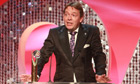 Adam Woodyatt, who spent nearly 30 years on EastEnders, receiving a lifetime achievement award at the British Soap Awards. Photograph: Joseph Scanlon/ITV