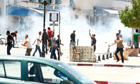 Protesters clash with riot police in the city of Kairouan