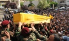 Hezbollah fighters in their military uniform, foreground, carry the coffin of Hezbollah fighter Hassan Faisal Shuker, 18, who was killed in a battle against Syrian rebels in the Syrian town of Qusair. Fierce street fighting in Qusair, Syria, near the Lebanese border has killed at least 28 elite members of Lebanon's militant Hezbollah group.