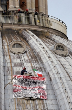 Italian businessman Marcello De Finizio stands on the dome of St Peter's basilica to protest against austerity measures on May 21, 2013 at the Vatican. The businessman hung  a banner saying: