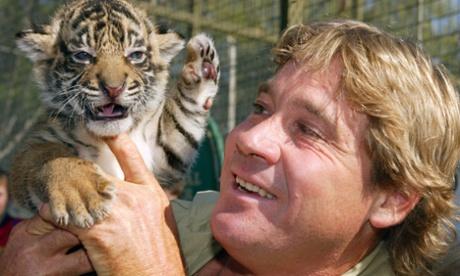 Steve Irwin holds a Sumatran tiger cub in 20