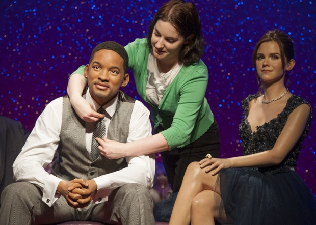 A Madame Tussauds assistant puts the finishing touches to a waxwork of Will Smith sitting next to err, Emma Watson. Will is on loan from Madame Tussauds Hollywood and has joined other recent additions, including George Clooney, for a ten week stay.