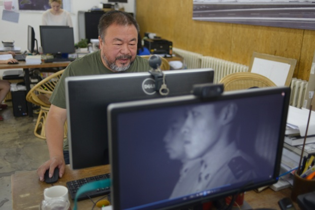 In his studio in Beijing, the artist and dissident Ai Weiwei reads comments online on the day he launched his latest project - a music video.