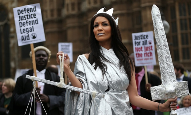 A protestor dressed as Lady Justice during a demonstration in support of Legal Aid near parliament in London. Lawyers are calling on the government to halt planned cuts to the system of legal aid in the United Kingdom.