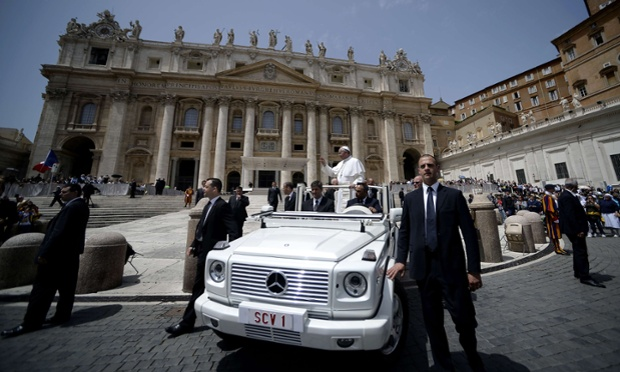 Pope Francis waves as he leaves after his weekly general audience in Saint Peter's square at the Vatican, Rome.