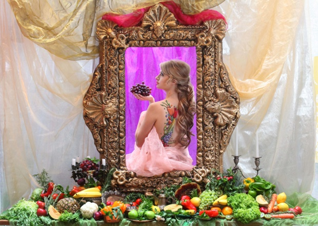 Chantelle Houghton gets fruity as she becomes a renaissance beauty for the day in a tableau by Greg Stone to celebrate National Vegetarian Week, at tibits vegetarian restaurant on Heddon Street in central London.