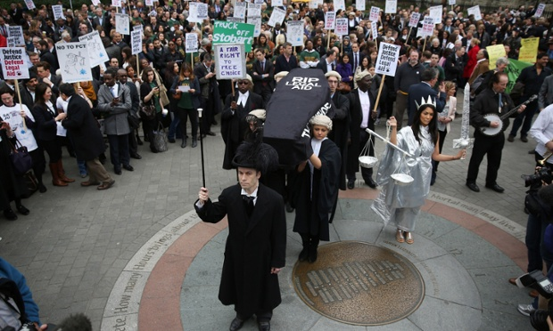 Demonstrators carry a coffin representing the death of Legal Aid near Parliament in London, England. Lawyers are calling on the government to halt planned cuts to the system of legal aid in the United Kingdom.
