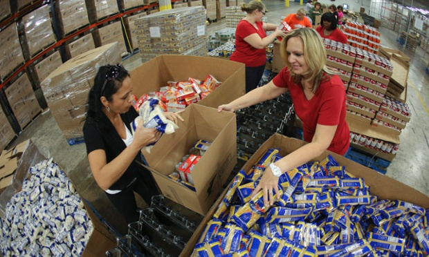 Volunteers fill boxes with nonperishables food items at the Feed the Children distribution centre in Oklahoma City to help tornado victims.