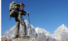 A female trekker trekking in the Everest region