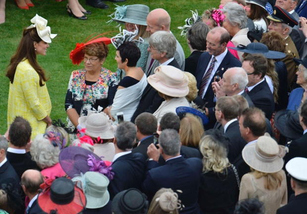 Catherine, Duchess of Cambridge attracts the guests at a Garden Party hosted by Queen Elizabeth II in the grounds of Buckingham Palace.