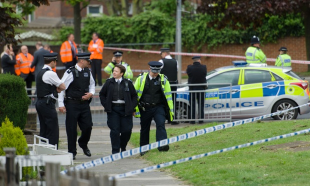 Police officers man a cordoned off area in Woolwich, east London following an incident in which a man was killed and two others seriously injured.