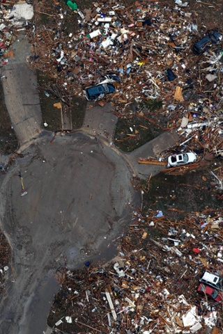 This aerial photo shows the remains of houses in Moore, Oklahoma as the clean-up from Monday's tornado begins.