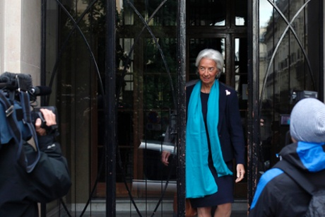 IMF Managing Director Christine Lagarde, leaves her apartment building before appearing in French court, in Paris, Thursday, May 23, 2013.