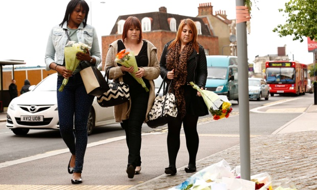 Women prepare to lay flowers near the scene of the soldier's murder in Woolwich, south-east London. Date: 23 May 2013.