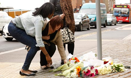 Women lay flowers near the scene of the killing of a British soldier in Woolwich, southeast London