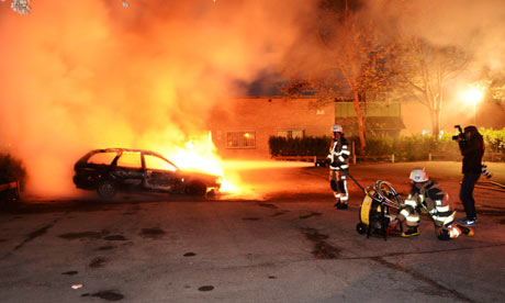 A burning car in the Stockholm suburb of Kista