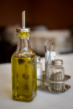 The offending item. The European Union decreed on Thursday that restaurants in its 27-nation market can continue to put refillable olive-oil bottles on tables, dropping a ban that was scheduled to take effect in 2014.