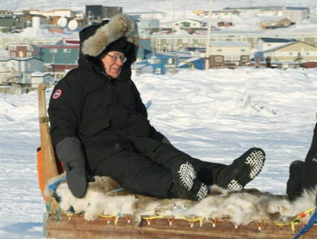 Any excuse to wheel out this picture... Mervyn King riding a dog sled in Canada in 2010. King says the growth vs austerity debate has been exaggerated.
